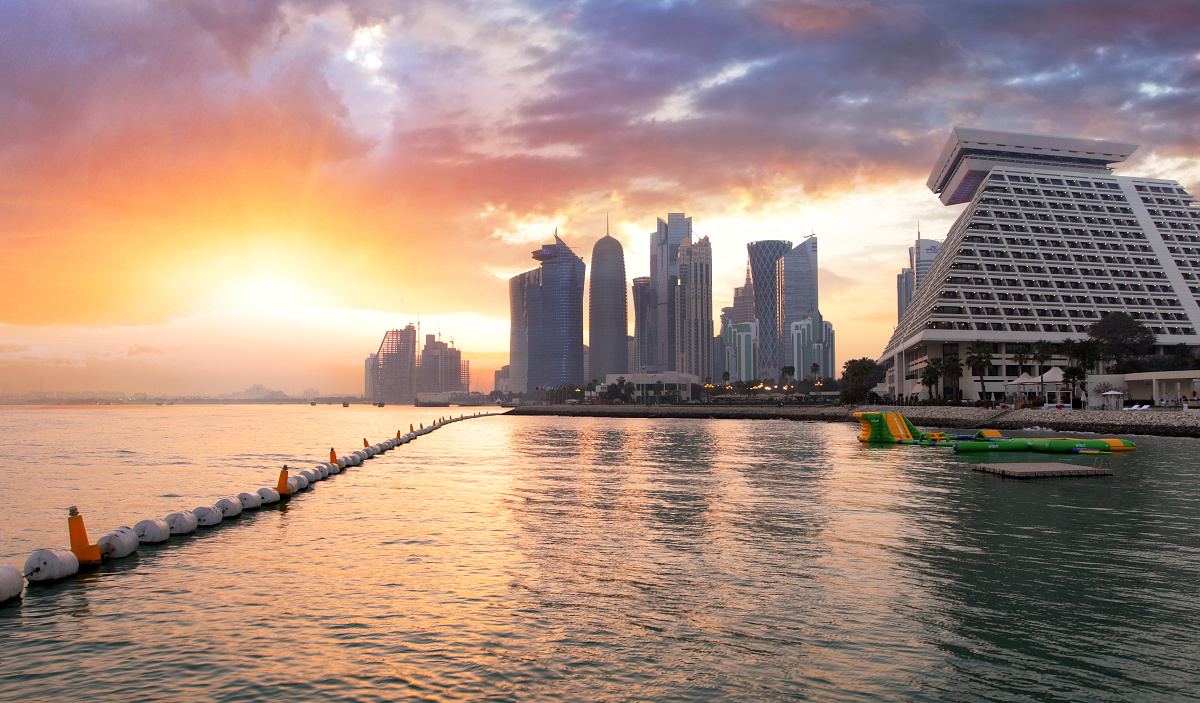 Qatar, Doha skyline at dramatic sunset