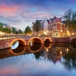 Amsterdam at night with light bridge