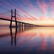 Dramatic sunrise over Vasco da Gama bridge